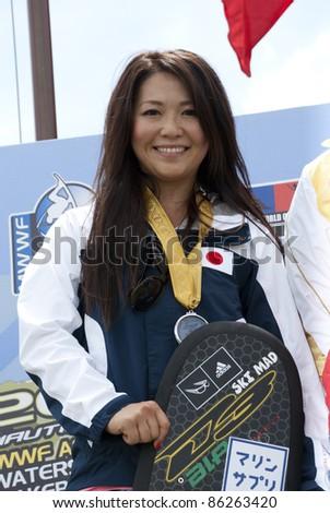 PUTRAJAYA, MALAYSIA - OCTOBER 9: Saaya Hirosawa from Japan wins the silver medal at 2011 IWWF Asian Waterski & Wakeboard Championships in Putrajaya, Malaysia on October 9, 2011. - stock photo