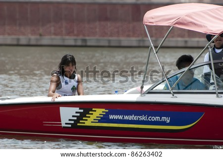 PUTRAJAYA, MALAYSIA - OCTOBER 9: Sasha Cristian from Singapore feel sad after failed show, her best at 2011 IWWF Asian Waterski & Wakeboard Championships in Putrajaya, Malaysia on October 9, 2011. - stock photo