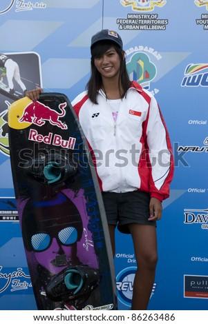 PUTRAJAYA, MALAYSIA - OCTOBER 9: Shasa Christian from Singapore wins the bronze medal at 2011 IWWF Asian Waterski & Wakeboard Championships in Putrajaya, Malaysia on October 9, 2011. - stock photo