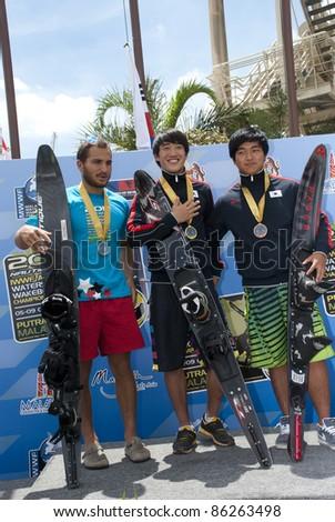 PUTRAJAYA, MALAYSIA - OCTOBER 9: The winners of open Men Slalom at 2011 IWWF Asian Waterski & Wakeboard Championships in Putrajaya, Malaysia on October 9, 2011. - stock photo