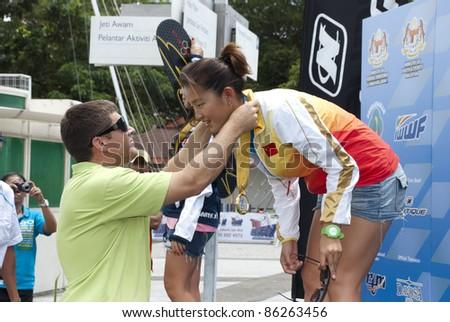 PUTRAJAYA, MALAYSIA - OCTOBER 9: Yu Fei Song from China wins the gold medal at 2011 IWWF Asian Waterski & Wakeboard Championships in Putrajaya, Malaysia on October 9, 2011. - stock photo