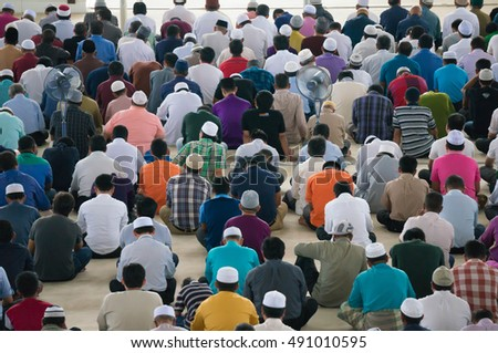 PUTRAJAYA - SEPT 23, 2016: Muslim performing Friday prayers at Tuanku Mizan Mosque on September 23, 2016 in Putrajaya Malaysia. Friday prayer is perform just after noon in the place of dhuhr