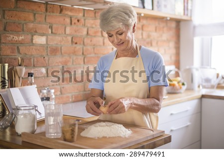 Putting all ingredients into the pastry  - stock photo