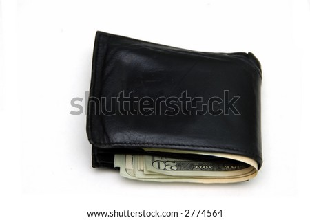 Putting back money in the wallet as savings - stock photo