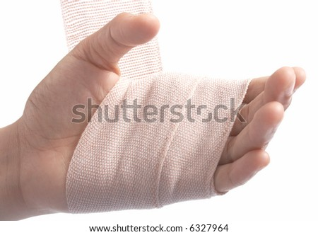 putting bandage on a hand over a white background