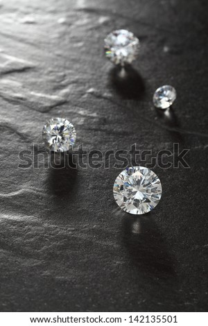 putting diamonds on the surface of the stone closeup.  - stock photo