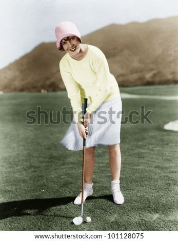 PUTTING FOR BIRDIE - stock photo