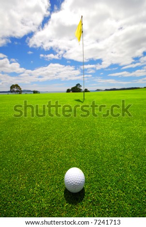 Putting for parr on the green on a beautiful golf course... - stock photo
