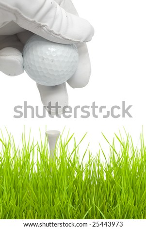 putting golf ball on a tee isolated against white background
