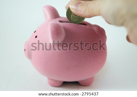 Putting money into a Piggy bank on a white background - stock photo