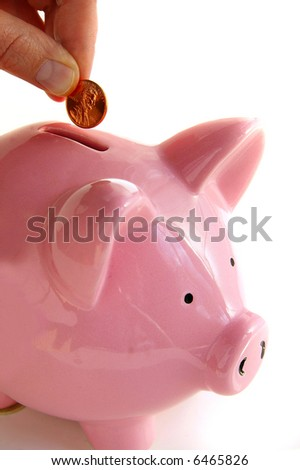 Putting money into the piggy bank, on white