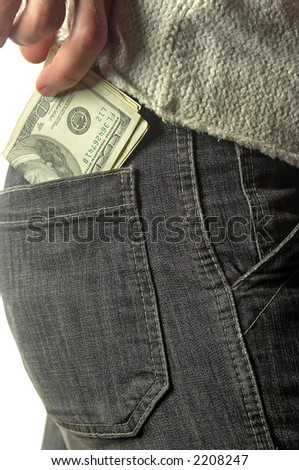 putting money into the pocket - stock photo
