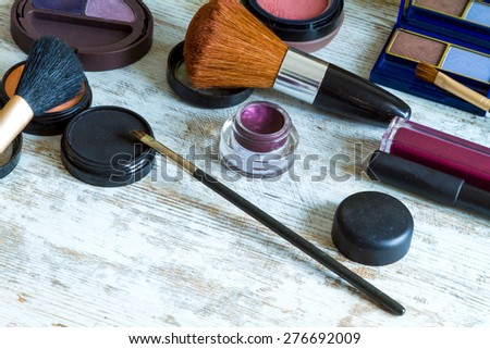 Putting on make up before going out