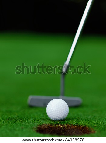 Putting on the green of a golf course - stock photo