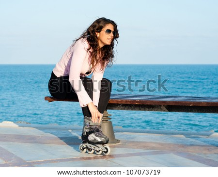 Putting on the rollerblades and getting ready for the skating fun