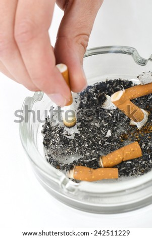 Putting out a cigarette - stock photo