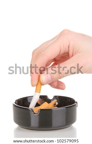 Putting out cigarette butt isolateed on white - stock photo