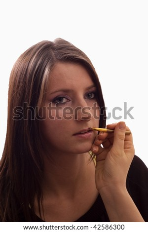 Putting the make-up on the face
