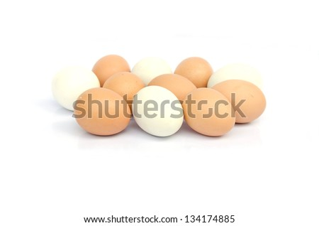 Putting together the eggs on a white background - stock photo