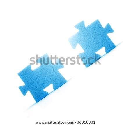 Putting two pieces of puzzles together. Conceptual image - stock photo