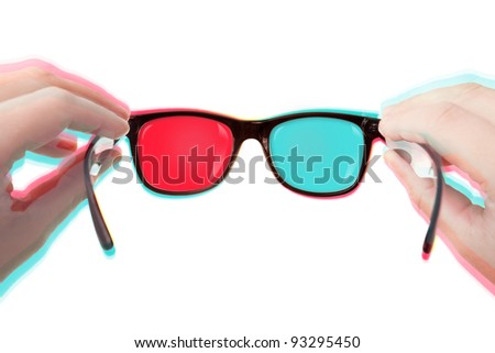 Putting Your 3D glasses on (isolated over white background) - stock photo