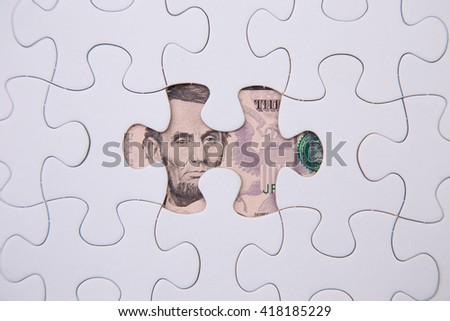 puzzle and dollar