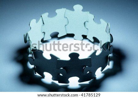 Puzzle concept teamwork - stock photo