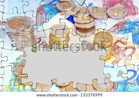 Puzzle - euro banknotes and euro coins with empty text box / euro money - stock photo