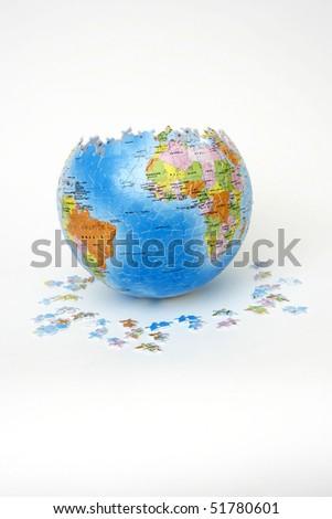 Puzzle globe on white background - stock photo