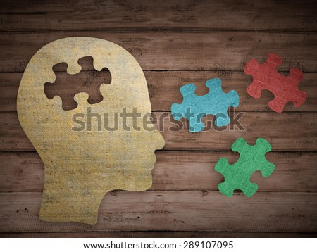 Puzzle head brain concept. Human head profile made from brown paper with a jigsaw piece cut out. Choose your personality that suit you - stock photo