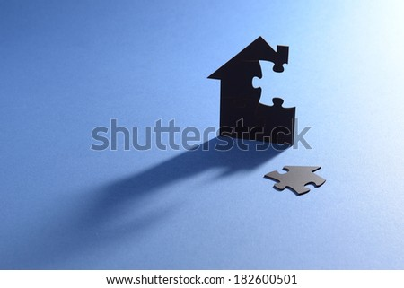 puzzle house - stock photo