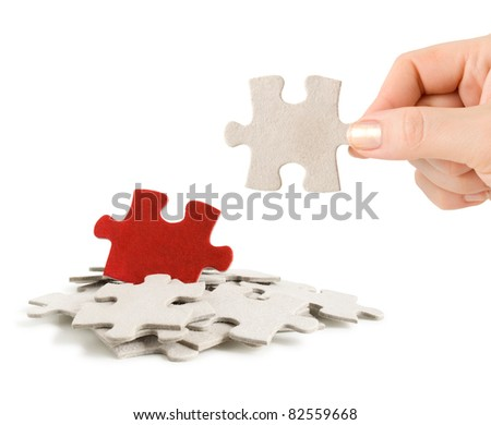 puzzle in hand and heap puzzles isolated on white