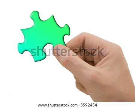 Puzzle in hand, isolated on white background - stock photo