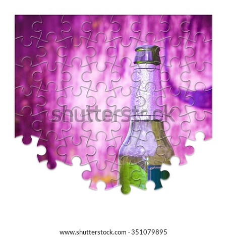 Puzzle of a bottle of beer resting on the ground - alcohol addiction concept image - stock photo