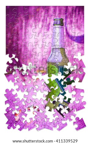 Puzzle of a bottle of beer resting on the ground - Free themselves from alcohol addiction - concept image - stock photo