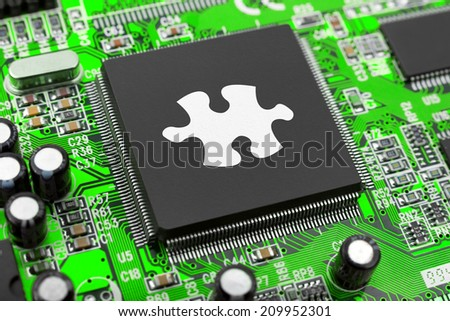 Puzzle on computer chip - technology background - stock photo