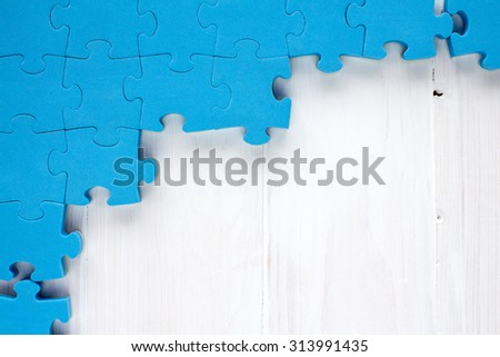 Puzzle on white wooden background.Team business concept - stock photo