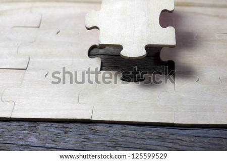 Puzzle on wooden boards team business concept - stock photo