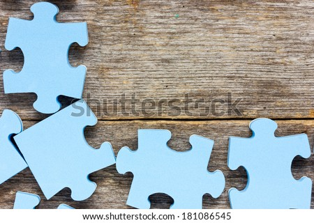 Puzzle on wooden boards.Team business concept  - stock photo