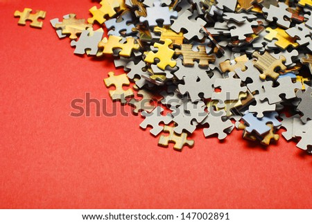 puzzle over a red background - stock photo