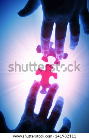 puzzle piece coming down into its place - stock photo