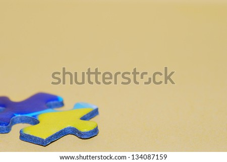 puzzle piece in big close up macro side vertical format - stock photo