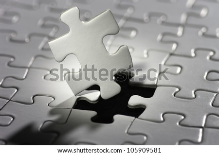 Puzzle piece in spot light. - stock photo