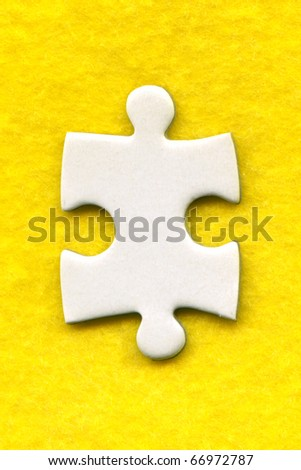 puzzle piece on a yellow background - stock photo
