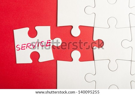 Puzzle piece which written service word inserted into group of white paper jigsaw puzzles - stock photo
