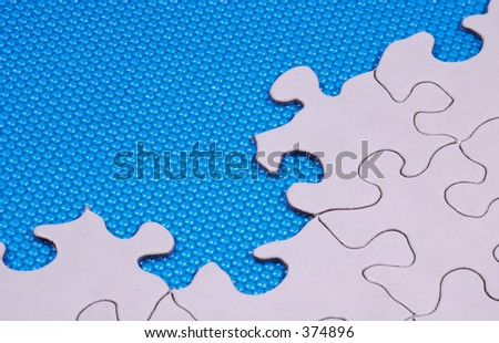Puzzle Pieces and a Blue Textured Background.
