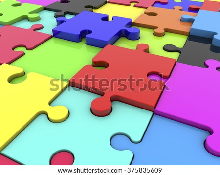 Puzzle pieces in various colors  - stock photo