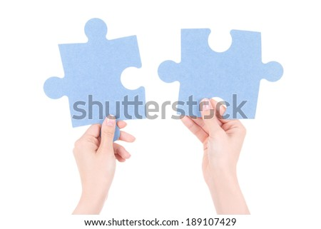 puzzle pieces in woman hands isolated on white background