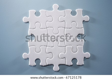 Puzzle pieces isolated on the blue background - stock photo