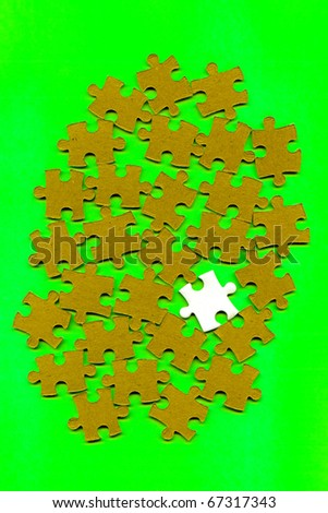puzzle pieces on a green background - stock photo